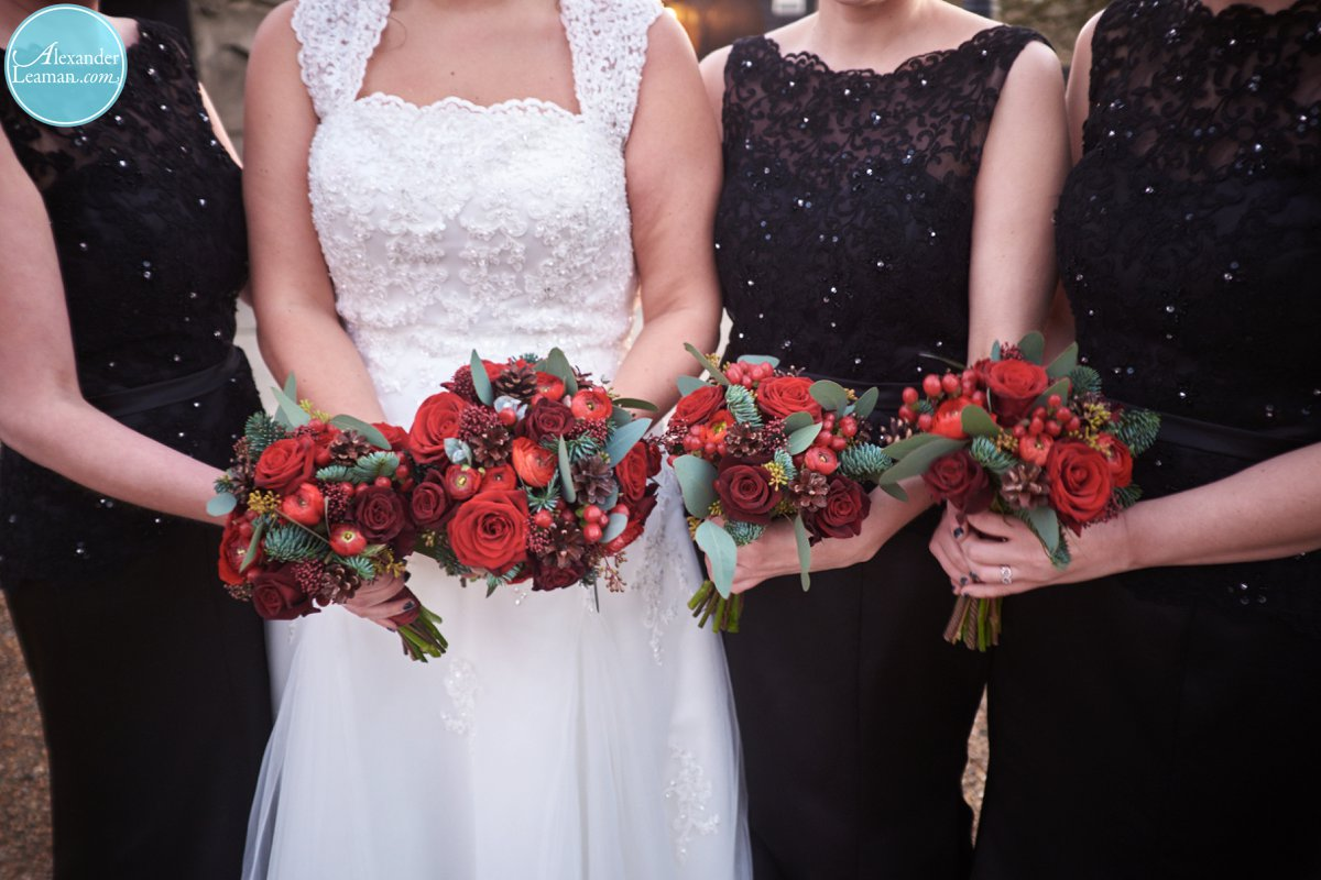 Black Bridesmaids dresses and Christmas Flowers